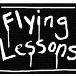 Flying Lessons sign with wet paint